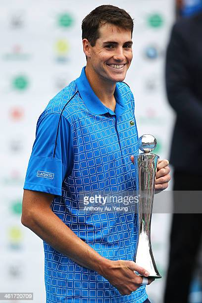 John Isner of United States poses with the trophy after winning the singles final against Yen Hsun Lu of Taiwan during day six of the Heineken Open...