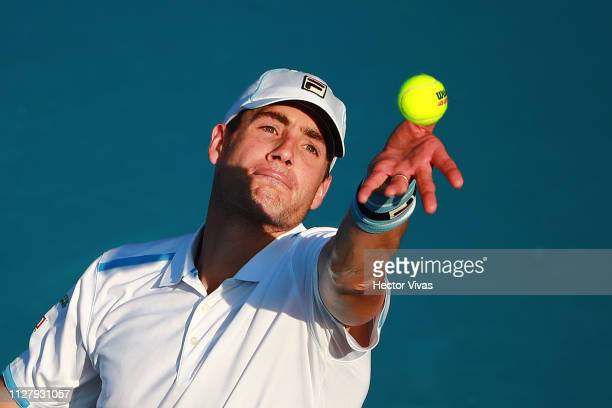 John Isner of United States serves during the match against Querrey of United States as part of the day 3 of the Telcel Mexican Open 2019 at Mextenis...