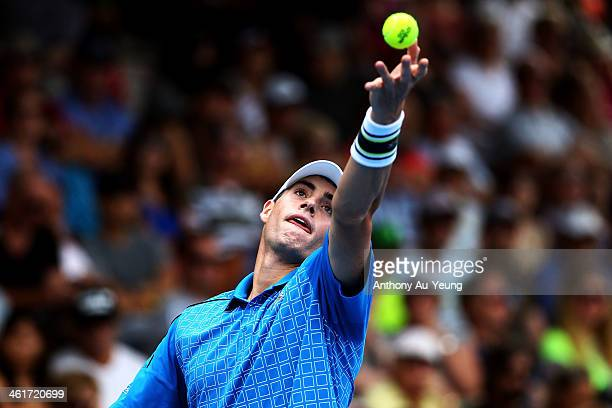 John Isner of United States serves in the singles final against Yen Hsun Lu of Taiwan during day six of the Heineken Open at ASB Tennis Centre on...