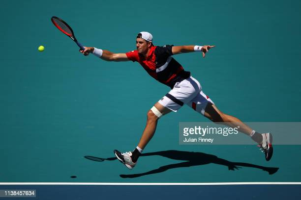 John Isner of USA in action against Kyle Edmund of Great Britain during the Miami Open tennis on March 26 2019 in Miami Gardens Florida