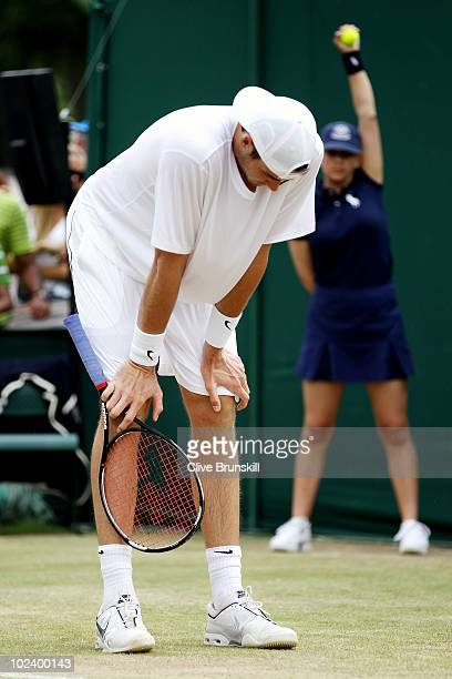 John Isner of USA in action during his match against Thiemo De Bakker of Netherlands on Day Five of the Wimbledon Lawn Tennis Championships at the...