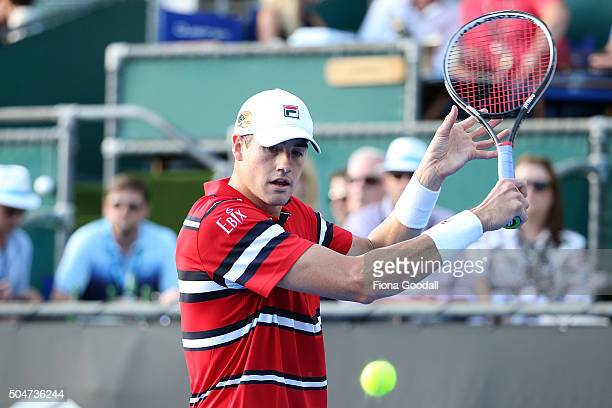 John Isner of USA plays a backhand shot to Sam Querrey of USA on day 3 of the ASB Classic on January 13 2016 in Auckland New Zealand