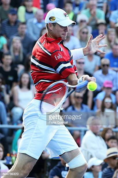 John Isner of USA plays a forehand shot to Sam Querrey of USA on day 3 of the ASB Classic on January 13 2016 in Auckland New Zealand