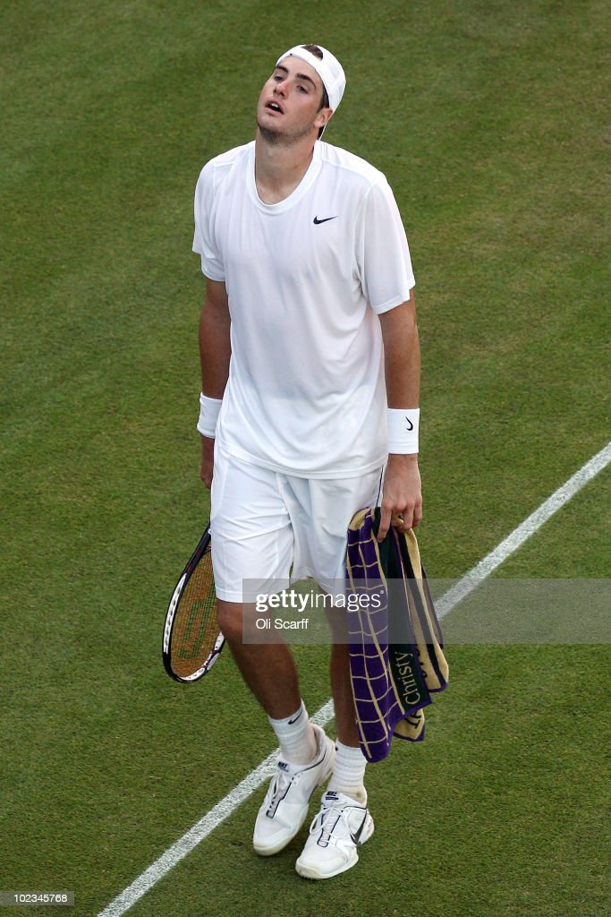 John Isner of USA reacts during his first round match against Nicolas Mahut of France on Day Three of the Wimbledon Lawn Tennis Championships at the All England Lawn Tennis and Croquet Club on June 23, 2010 in London, England.