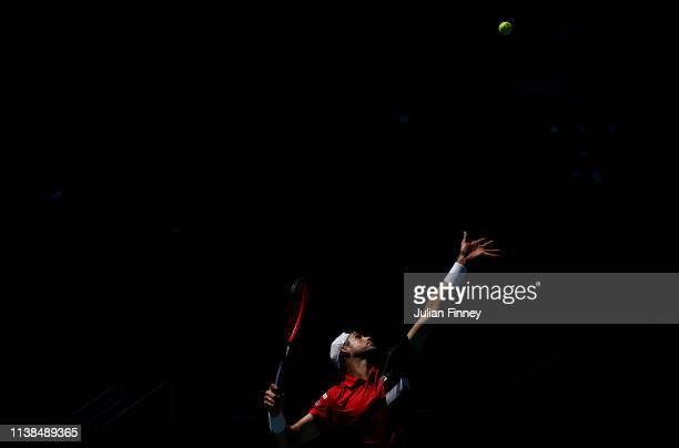 John Isner of USA serves to Kyle Edmund of Great Britain during the Miami Open tennis on March 26 2019 in Miami Gardens Florida