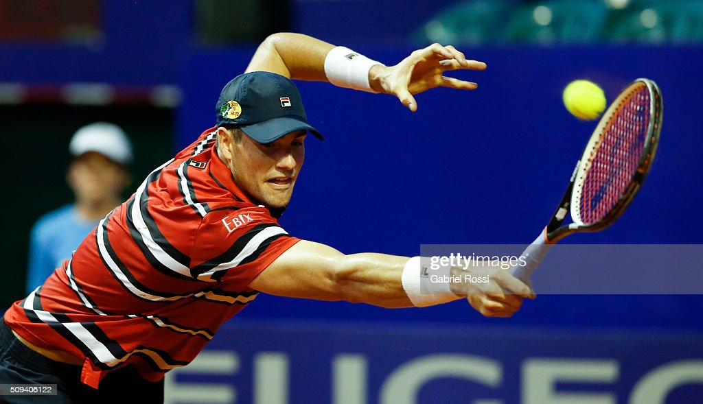 John Isner of USA takes a backhand shot during a match between John Isner of USA and Dusan Lajovic of Serbia as part of ATP Argentina Open at Buenos Aires Lawn Tennis Club on February 10, 2016 in Buenos Aires, Argentina.