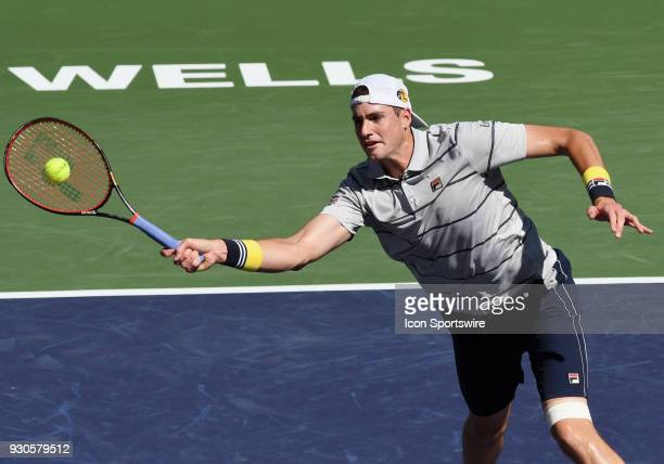 John Isner plays a shot near the net during the first set of a match played during the BNP Paribas Open played on March 11 2018 at the Indian Wells...