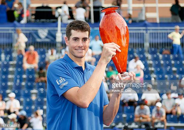 John Isner poses with the trophy after defeating Kevin Anderson of South Africa during the BBT Atlanta Open in Atlantic Station on July 28 2013 in...