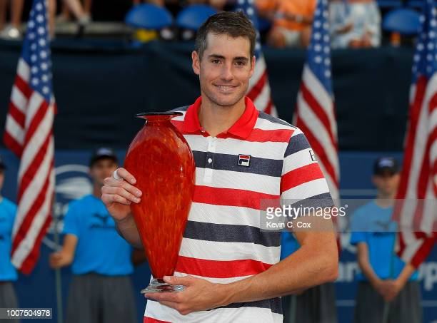 John Isner poses with the trophy after defeating Ryan Harrison during the BBT Atlanta Open at Atlantic Station on July 29 2018 in Atlanta Georgia