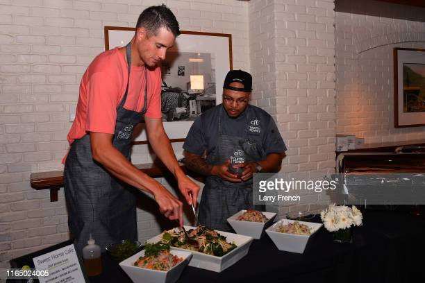 John Isner prepares food with Chef Jerome Grant at Citi Taste Of Tennis DC at The Hamilton on July 29, 2019 in Washington, DC.