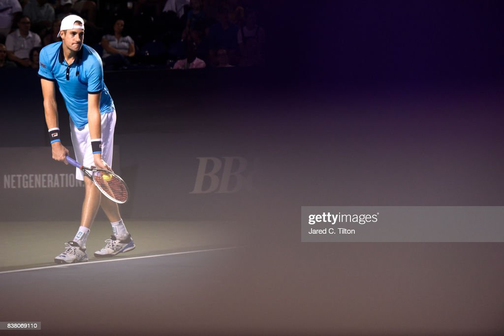 John Isner prepares to serve to Borna Coric of Croatia during the fifth day of the Winston-Salem Open at Wake Forest University on August 23, 2017 in Winston-Salem, North Carolina.