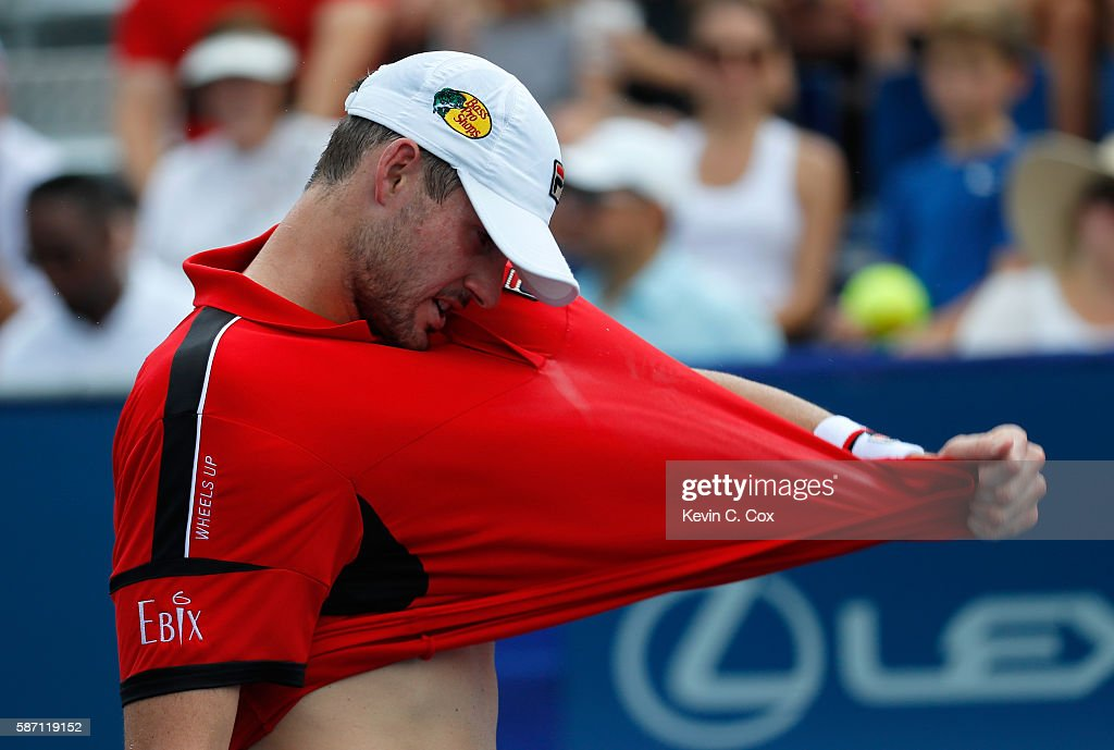 John Isner reacts after losing a game to Nick Kyrgios of Australia during the finals of the BB&T Atlanta Open at Atlantic Station on August 7, 2016 in Atlanta, Georgia.