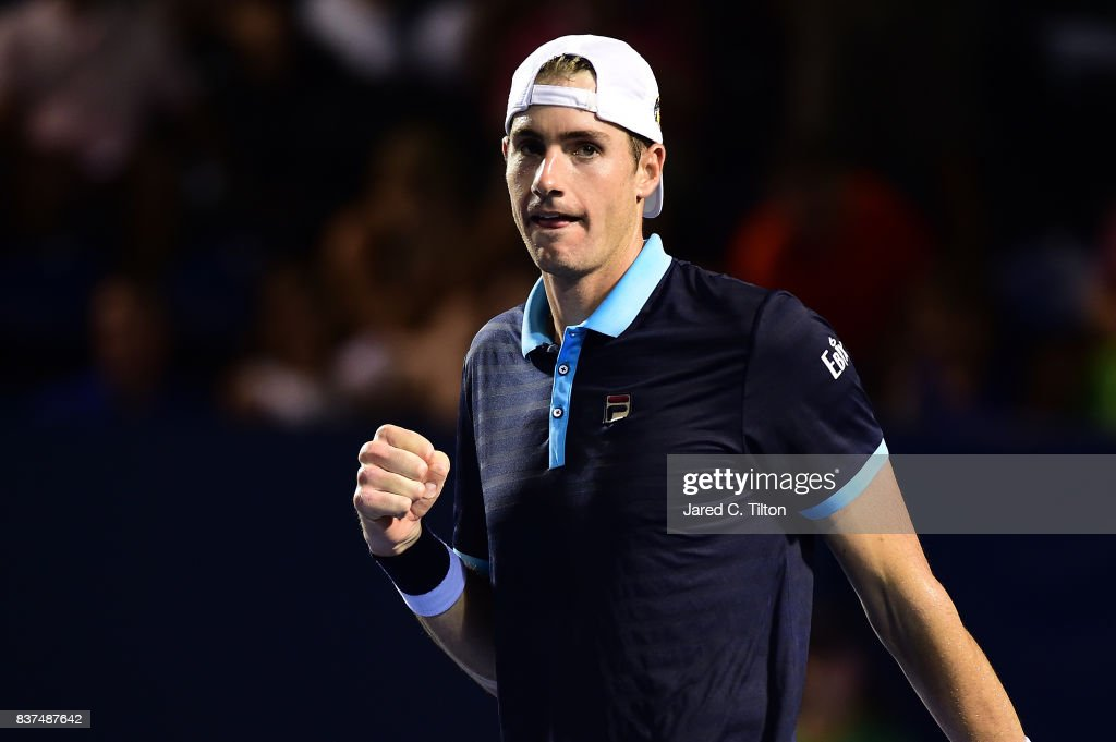 John Isner reacts after winning his match against Andrey Kuznetsov of Russia during the fourth day of the Winston-Salem Open at Wake Forest University on August 22, 2017 in Winston-Salem, North Carolina.