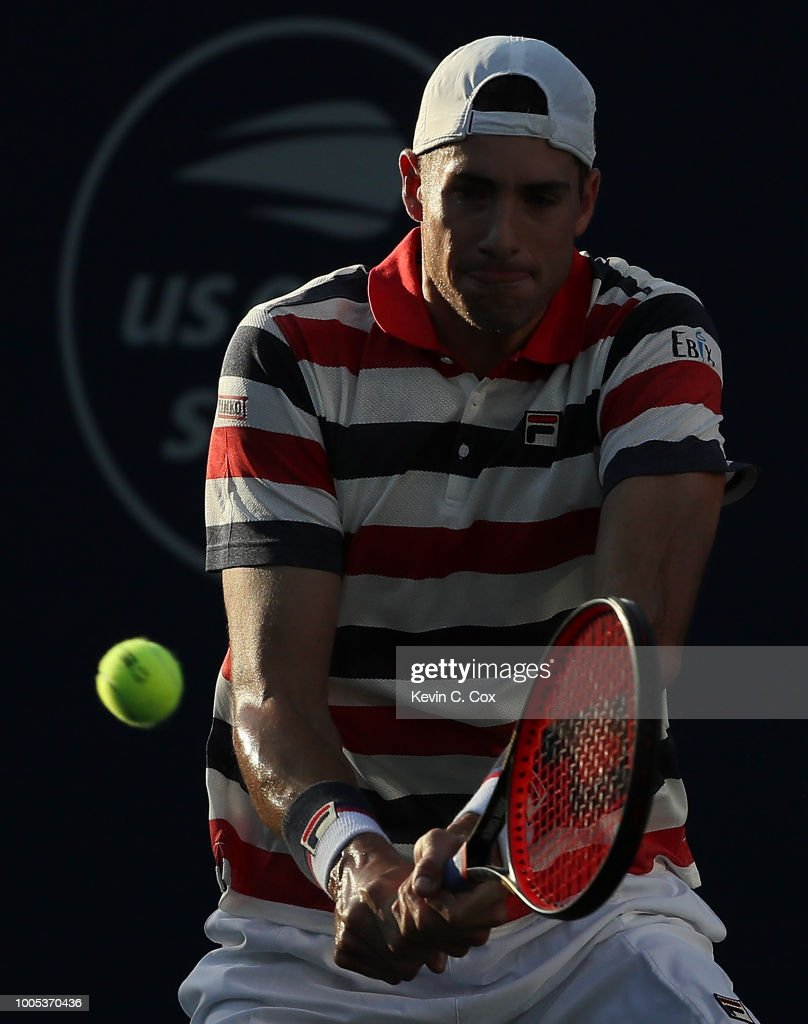 John Isner returns a backhand to Alex De Minaur of Australia during the BB&T Atlanta Open at Atlantic Station on July 25, 2018 in Atlanta, Georgia.