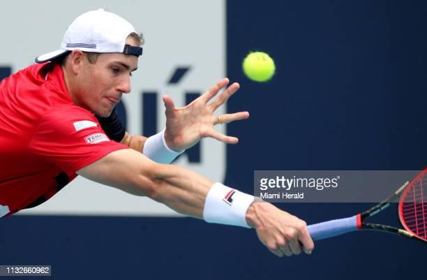 John Isner returns a ball hit by Albert RamosVinolas on Sunday March 2019 at the Miami Open in Miami Gardens Fla