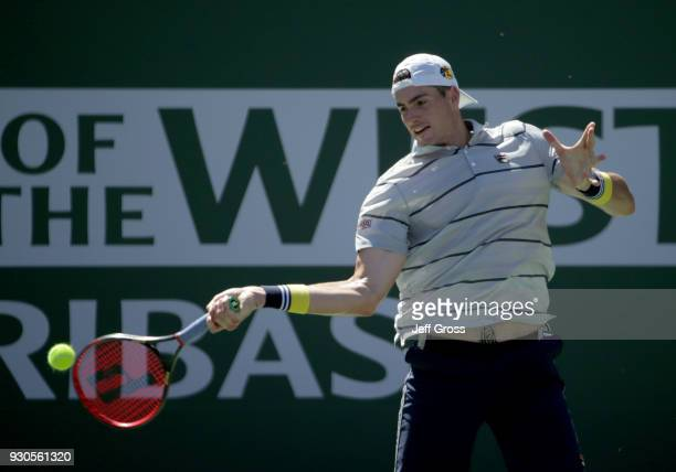 John Isner returns a forehand to Gael Monfils of France during the BNP Paribas Open on March 11 2018 at the Indian Wells Tennis Garden in Indian...