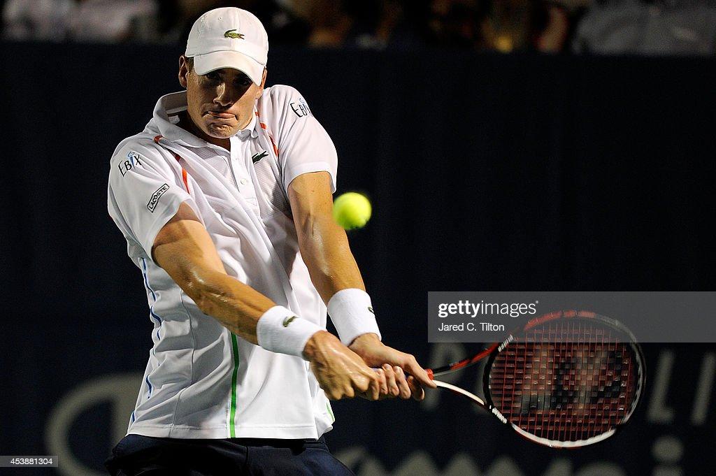 John Isner returns a shot from Mikhail Kukushkin of Kazakhstan during the Winston-Salem Open at Wake Forest University on August 20, 2014 in Winston Salem, North Carolina.