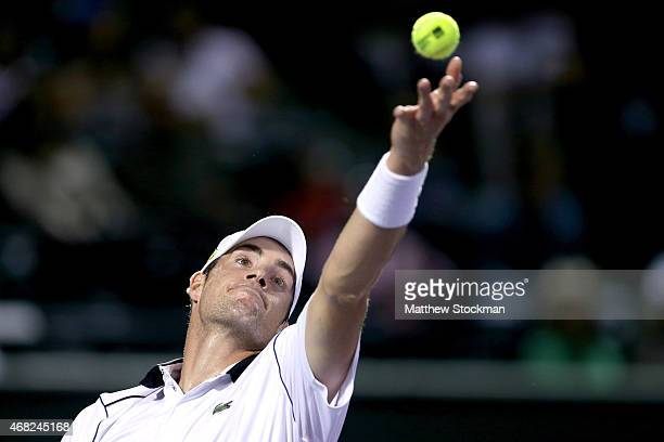 John Isner serves Milos Raonic of Canada during day 9 of the Miami Open Presented by Itau at Crandon Park Tennis Center on March 31, 2015 in Key...