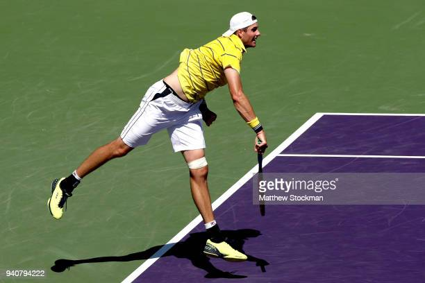 John Isner serves to Alexander Zverev of German during the men's final of the Miami Open Presented by Itau at Crandon Park Tennis Center on April 1...