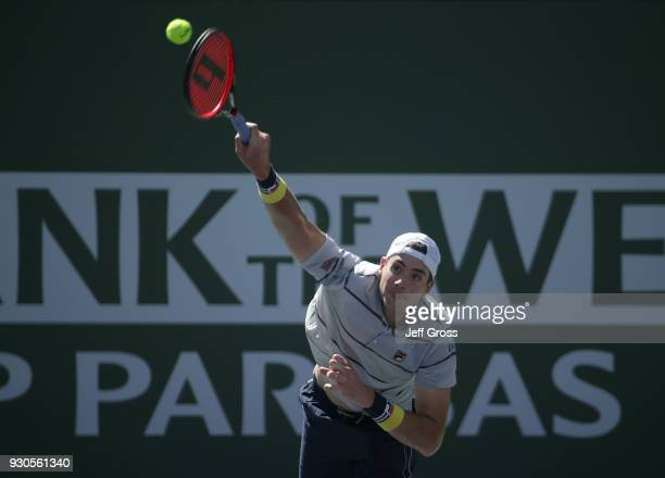 John Isner serves to Gael Monfils of France during the BNP Paribas Open on March 11 2018 at the Indian Wells Tennis Garden in Indian Wells California