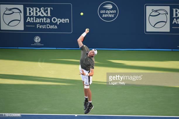 John Isner serves to Reilly Opelka during the BB&T Atlanta Open at Atlantic Station on July 24, 2019 in Atlanta, Georgia.