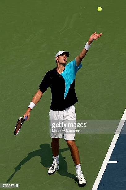 John Isner serves to Tommy Haas of Germany during the Legg Mason Tennis Classic at the William H.G. FitzGerald Tennis Center August 3, 2007 in...