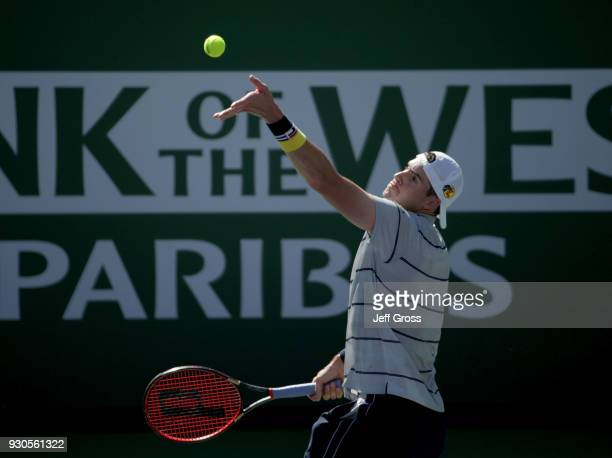 John Isner tosses the ball up before serving to Gael Monfils of France during the BNP Paribas Open on March 11 2018 at the Indian Wells Tennis Garden...