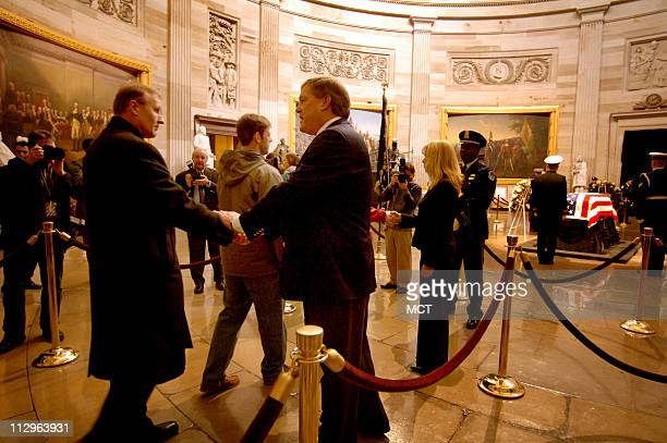 John Jack Ford the eldest son of President Gerald R Ford and his wife greet mourners as they arrive to view the casket of President Ford in the...
