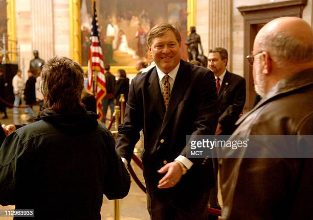 John Jack Ford the eldest son of President Gerald R Ford greets mourners as they arrive to view the casket of President Ford in the Rotunda of the US...