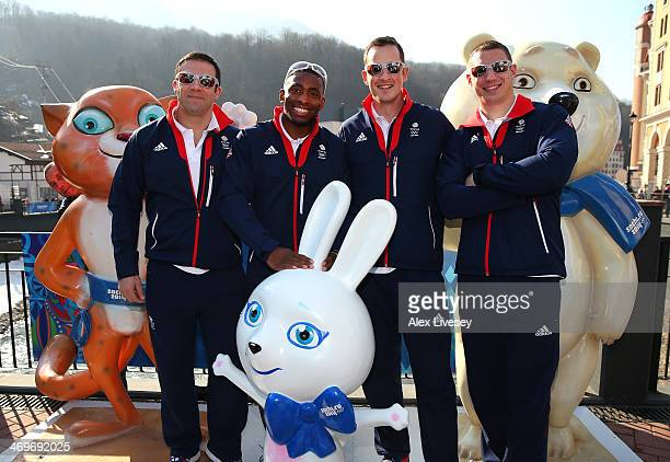 John Jackson Joel Fearon Stuart Benson and Bruce Tasker of the Great Britain Bobsleigh team pose with the mascots at the Rosa Khutor mountain village...