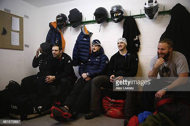 John Jackson Stuart Benson and Bruce Tasker of the Great Britain bobsleigh team wait in the athletes changing room prior to a practice session at the...