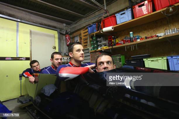 John Jackson Stuart Benson Bruce Tasker and Craig Pickering of the Great Britain bobsleigh team sit in their race positions as the GBR1 bobsleigh is...