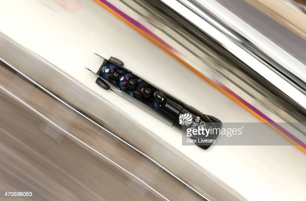 John Jackson Stuart Benson Bruce Tasker and Joel Fearon of Great Britain in action during a fourman bobsleigh practice session on Day 13 of the Sochi...