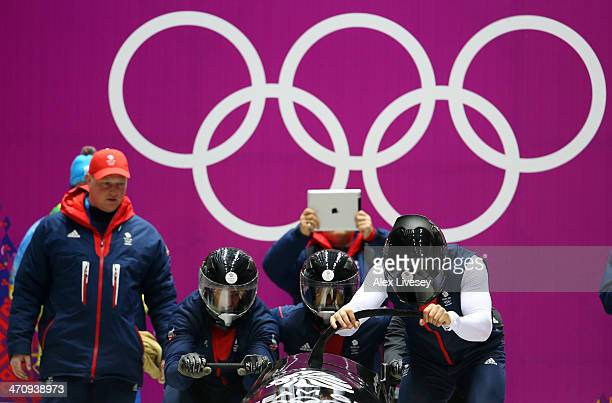 John Jackson Stuart Benson Bruce Tasker and Joel Fearon of Great Britain prepare to start during a fourman bobsleigh practice session on Day 14 of...