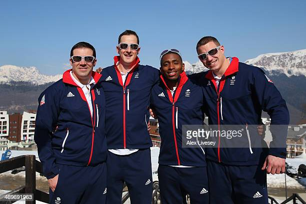 John Jackson Stuart Benson Joel Fearon and Bruce Tasker of Great Britain Bobsleigh team pose for a group photograph outside the athletes village in...