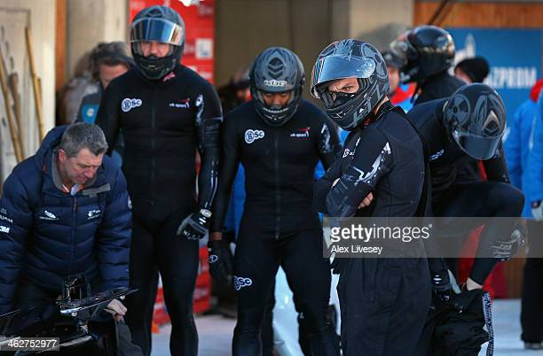 John Jackson the driver of the Great Britain Four Man Bobsleigh team looks down the track as team mates Bruce Tasker Joel Fearon and Stuart Benson...