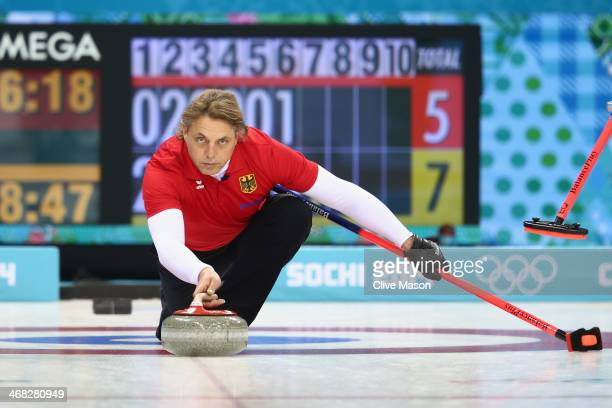 John Jahr of Germany in action during the round robin match against Canada during day 3 of the Sochi 2014 Winter Olympics at Ice Cube Curling Center...