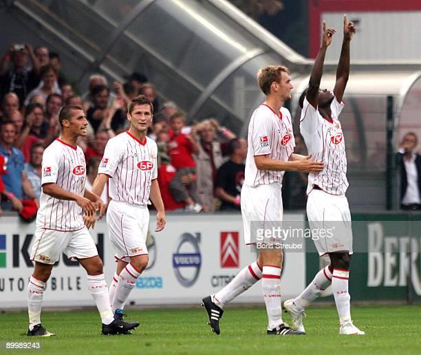 John Jairo Mosquera of Berlin celebrates the first goal with his team mates Karim Benyamina, Michael Bemben and Christian Stuff during the Second...