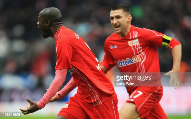 John Jairo Mosquera of Union celebrates with his team mate Torsten Mattuschka after scoring his team's first goal during the Second Bundesliga match...