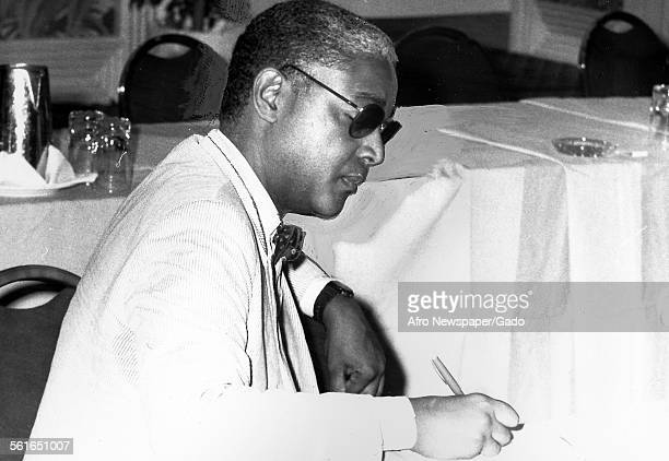 John Jake Oliver the publisher of Afro American newspaper in Baltimore seated writing with a pen Baltimore Maryland 1961