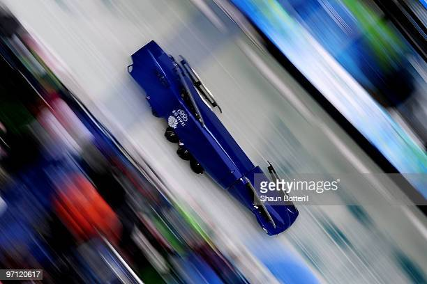 John James Jackson Henry Nwume Dan Money and Allyn Condon of Great Britain and Northern Ireland crash in Great Britain 1 during the fourman bobsleigh...