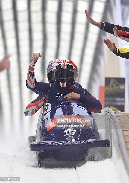 John James Jackson of Great Britian crosses the finish line during the 4 man Bobsleigh Viessman FIBT Bob Skeleton World Cup at the Sanki Sliding...