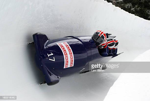 John James Jackson Stuart Benson Bruce Tasker and Joel Fearon of Great Britain compete during the Four Men Bobsleigh heat one of the IBSF Bob...