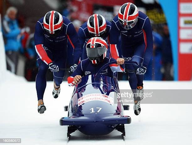 John James Jackson Stuart Benson Bruce Tasker and Joel Fearon of Great Britain compete during the Four Men Bobsleigh heat three of the IBSF Bob...