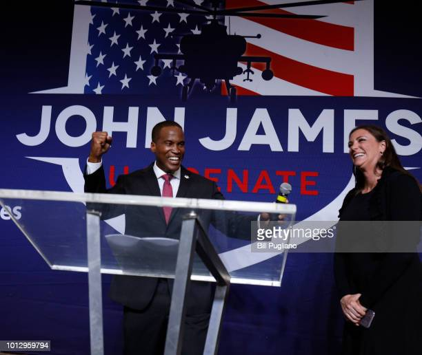 John James Michigan GOP Senate candidate celebrates his wife Elizabeth announcing that she is pregnant with a boy at an election night event after...