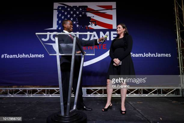 John James Michigan GOP Senate candidate listens to his wife Elizabeth announce that she is pregnant with a boy at an election night event after...
