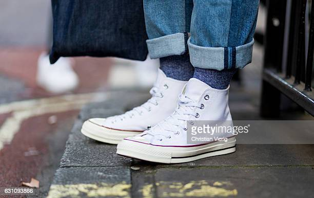 John Jarrett wearing denim pants denim bag white Converse sneaker during London Fashion Week Men's January 2017 collections at Topman on January 6...