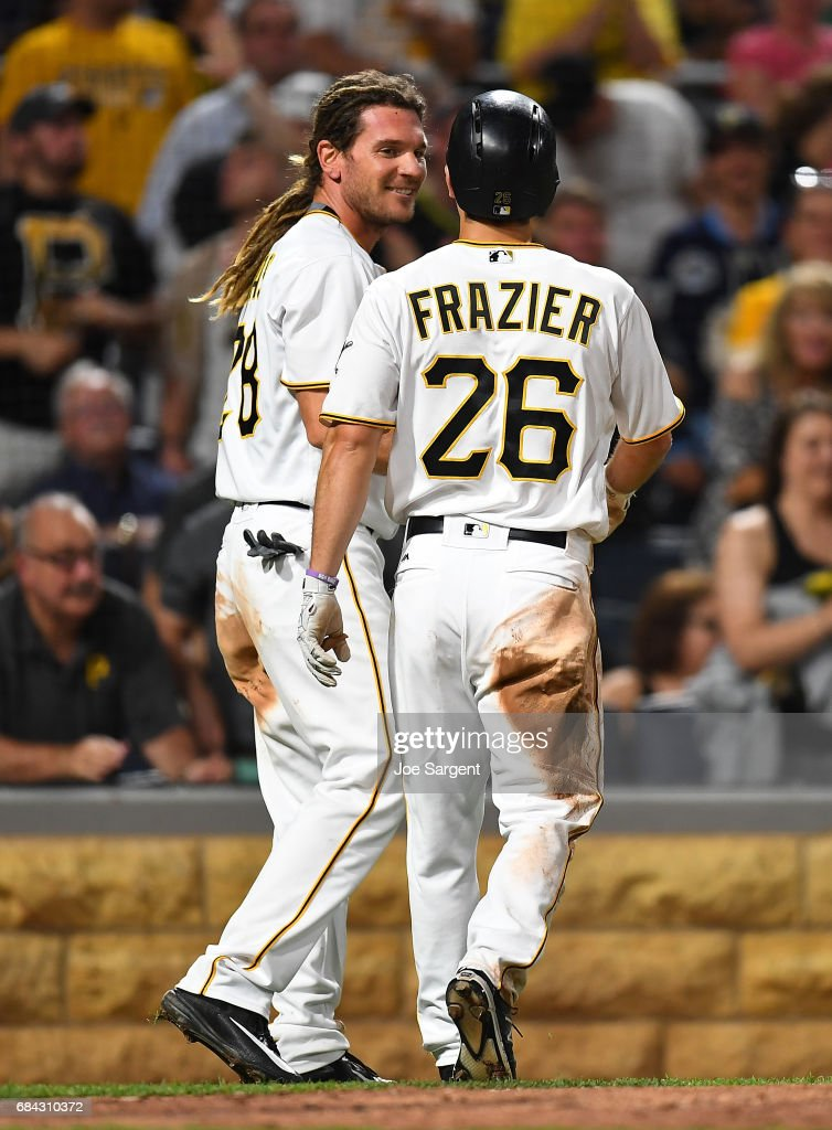 John Jaso #28 and Adam Frazier #26 of the Pittsburgh Pirates celebrate after scoring in the seventh inning against the Washington Nationals at PNC Park on May 17, 2017 in Pittsburgh, Pennsylvania.