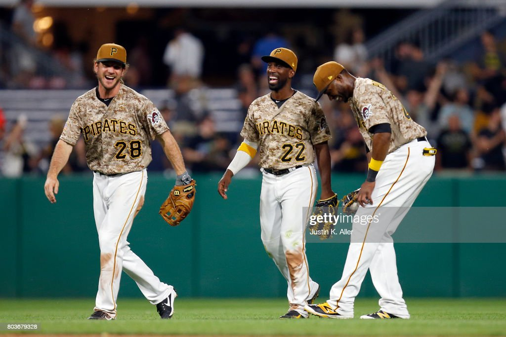 John Jaso #28, Andrew McCutchen #22 and Gregory Polanco #25 of the Pittsburgh Pirates celebrates after defeating the Tampa Bay Rays 4-0 during inter-league play at PNC Park on June 29, 2017 in Pittsburgh, Pennsylvania.