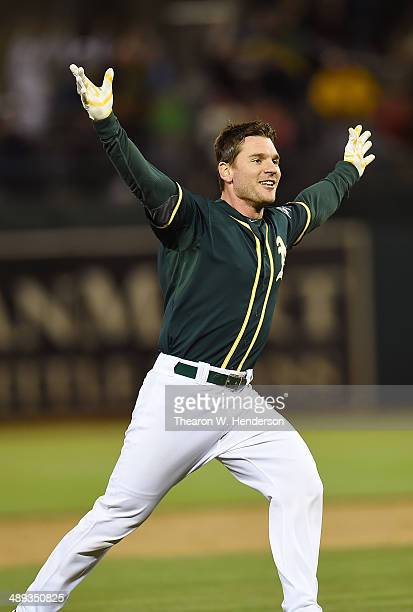 John Jaso of the Oakland Athletics celebrates after he hit a walkoff RBI double scoring Nick Punto to defeat the Washington Nationals in the Bottom...